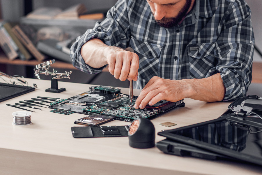 Technician refurbishing a laptop